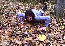 Man crawling in leaves
