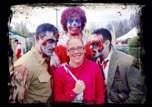 Woman sorrounded by zombies